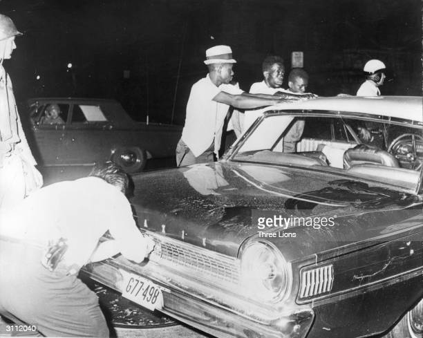Black civil rights protesters are arrested by American police during race riots in Newark, New Jersey.