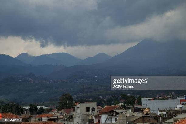 Black clouds cover the hilly area in Tanjungsari, Sumedang Regency.