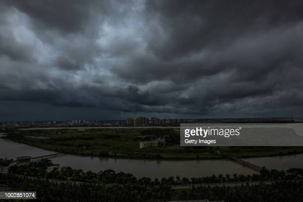Black clouds hang over the city as Typhoon Son-Tinh lands on July 18, 2018 in Haikou, Hainan Province of China. Typhoon Son-Tinh, the ninth typhoon...