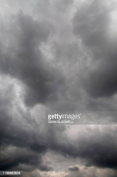 black clouds - moody sky stock pictures, royalty-free photos & images