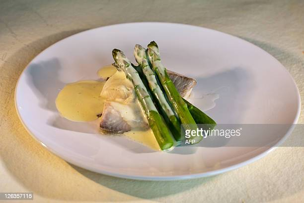 Black cod with black truffle foam and asparagus a dish by Slovenia's Ana Ros at Exquisite Corpse in New York City's Chelsea district September 24...