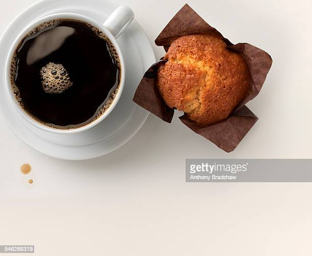 Black coffee and golden muffin