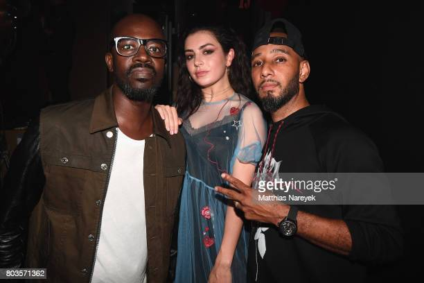 Black Coffee Charli XCX and Swizz Beatz pose at Bacardi X The Dean Collection Present No Commission Berlin on June 29 2017 in Berlin Germany