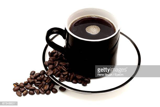 Black Coffee Cup With Beans In Plate On White Background