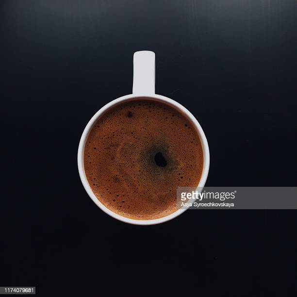 black coffee in a white cup on a black background - black coffee stock pictures, royalty-free photos & images