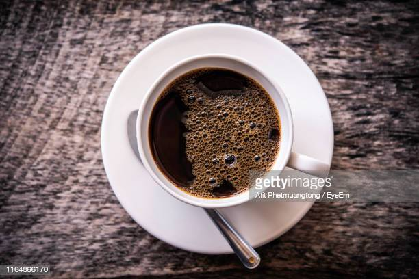 black coffee in cup on table - black coffee stock pictures, royalty-free photos & images