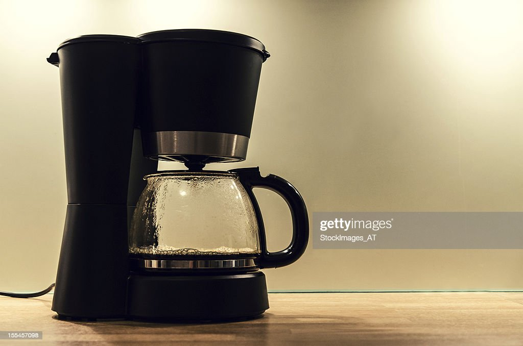 Black coffee machine, making a pot of hot coffee : Stock Photo