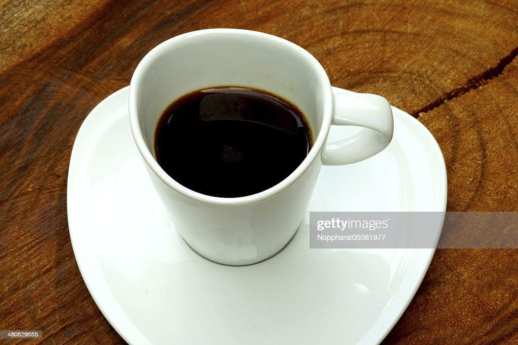 Black Coffee on a wood background. : Stock Photo