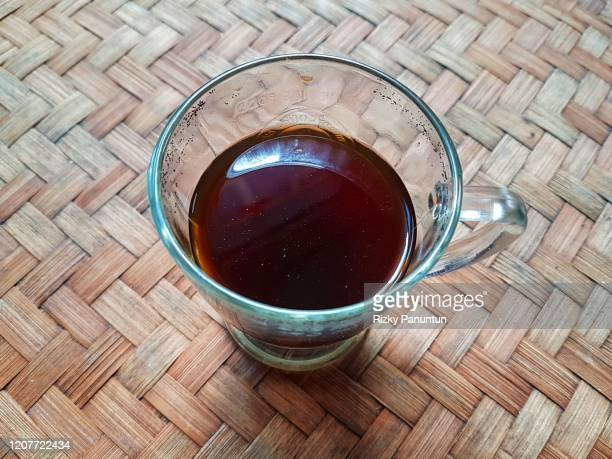 black coffee on woven bamboo table - black bamboo stock pictures, royalty-free photos & images