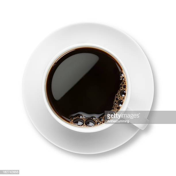 black coffee with bubbles in white cup with saucer - espresso stock photos and pictures