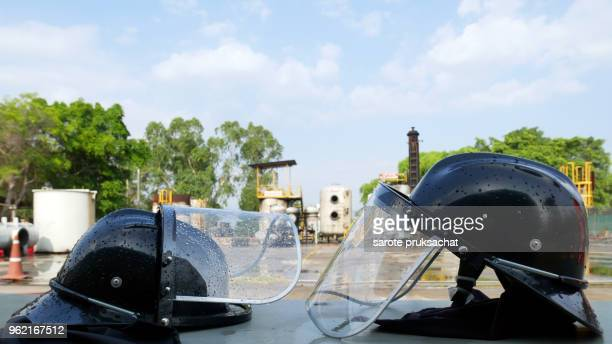Black color fireman hats on table close up .Emergency and rescue concept .