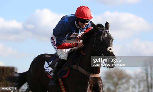Black Corton and Bryony Frost clear the last fence before going on to win The Sodexo Reynoldstown Novicesâ Steeple Chase Race run during The Betfair...