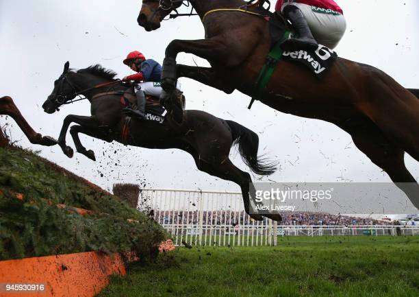 Black Corton ridden by Bryony Frost jumps a fence during the Betway Mildmay Novices' Chase on Ladies Day at Aintree Racecourse on April 13 2018 in...