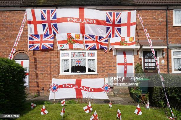 Black country home is adorned with the St George and Union flags as people take part in the annual Stone Cross St George's Day Parade on April 22...
