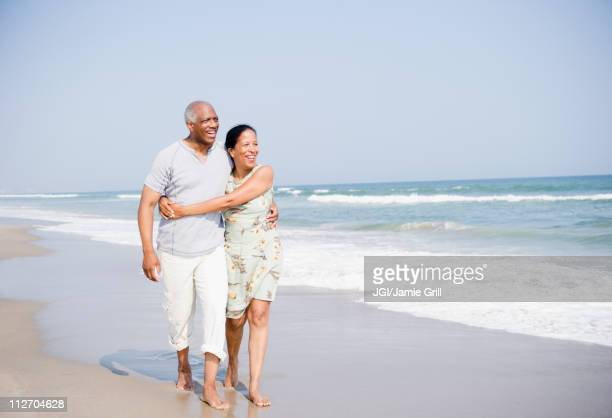 Black couple enjoying beach together