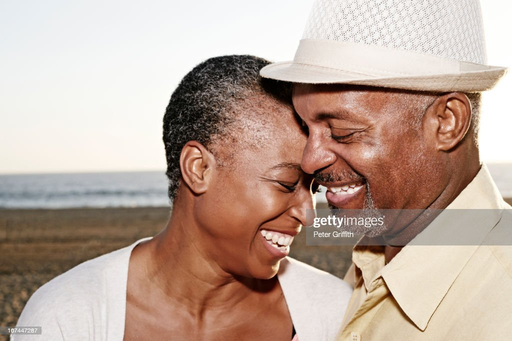 Black couple hugging outdoors