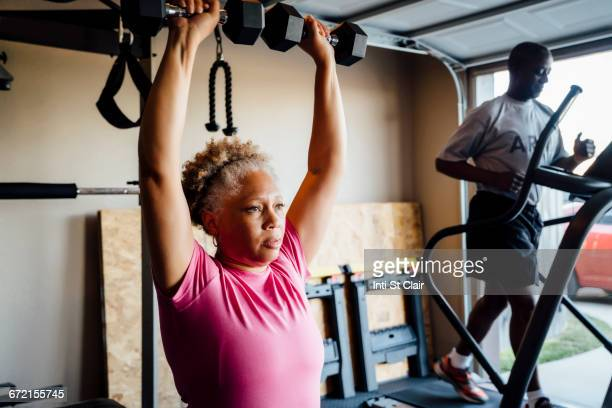 black couple lifting working out in garage - military exercise stock pictures, royalty-free photos & images