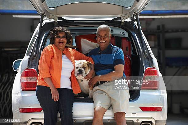 Black couple loading car for vacation