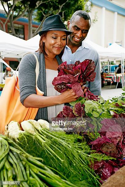 Black couple shopping at outdoor market