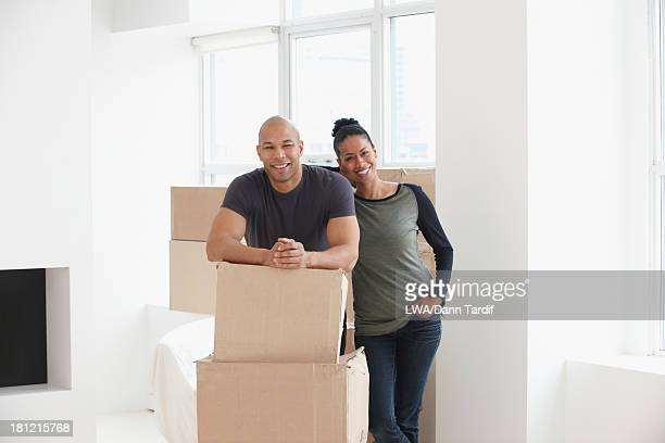 Black couple smiling in new house