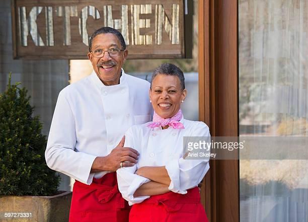 Black couple smiling outside restaurant