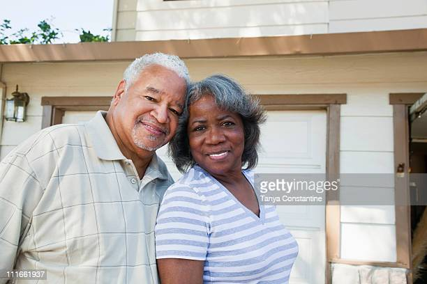 black couple standing together in driveway - tanya constantine stock pictures, royalty-free photos & images