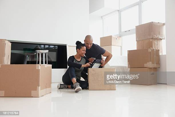 Black couple unpacking in new house