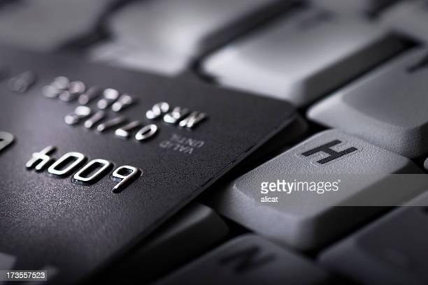 Black Credit Card on Computer Keyboard