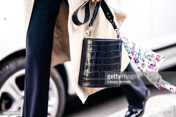A black crocodile leather bag is seen outside Haider Ackermann during Paris Fashion Week Womenswear Spring/Summer 2019 on September 29 2018 in Paris...