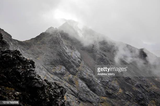 black cuillin mountain ridge in mist, fog, cloud, isle of skye - ridge stock pictures, royalty-free photos & images