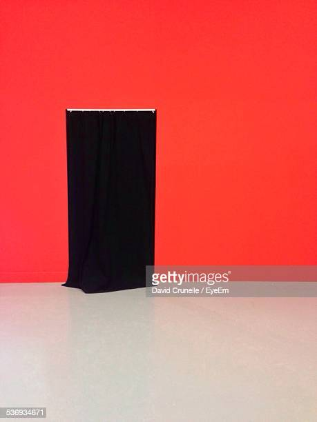 Black Curtain At Entrance On Red Wall