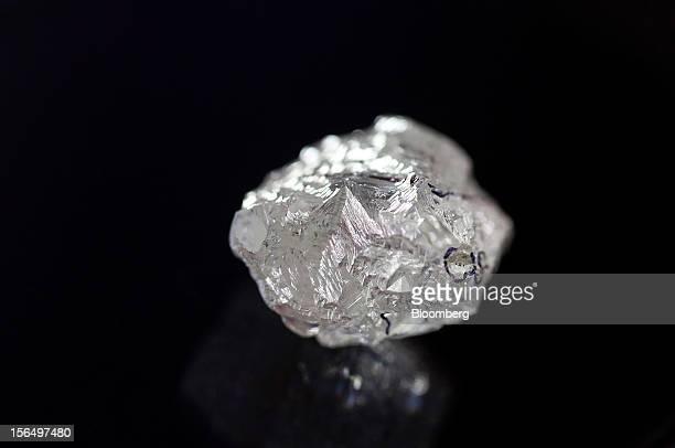 Black cutting marks are seen on an uncut 20 carat diamond at the Shrenuj Botswana Ltd sightholder office in Gaborone Botswana on Thursday Oct 25 2012...