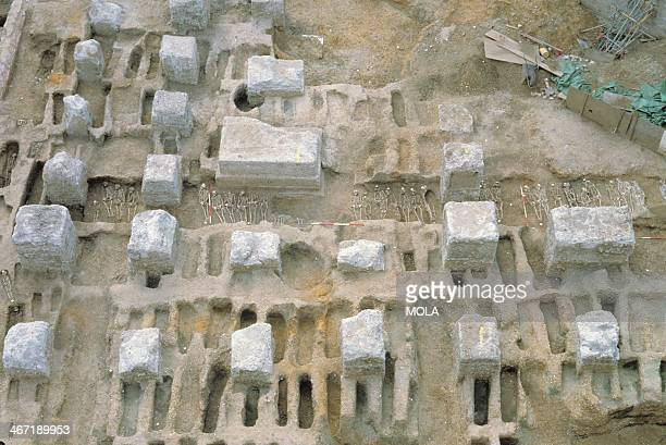Black Death burial trench under excavation between rows of individual graves , East Smithfield, London. Burials were carefully, though densely,...
