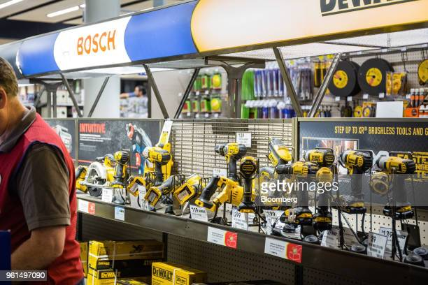 Black Decker Inc DeWalt brand power drills stand on display for sale at a Lowe's Cos store in New York US on Tuesday May 22 2018 Lowe's Cos is...