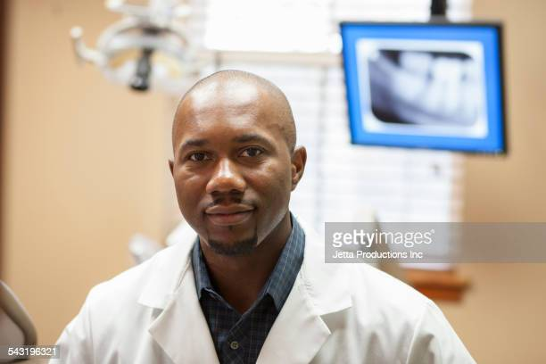 Black Dentist Standing In Office