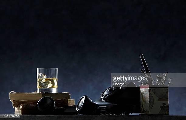 Black: Desk with Pens, Pencils, Books and Glass of Scotch