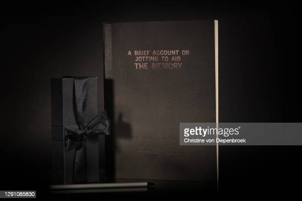 black diary and giftbox on black background - thinking of you card stock pictures, royalty-free photos & images