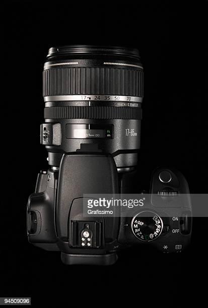 Black digital camera on dark background
