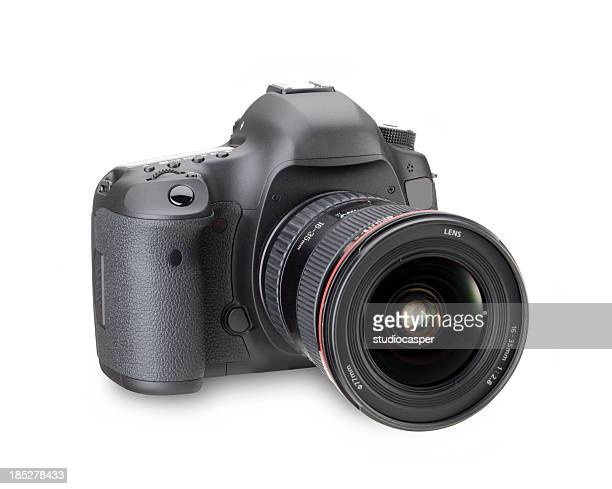 Black digital SLR camera in a white background