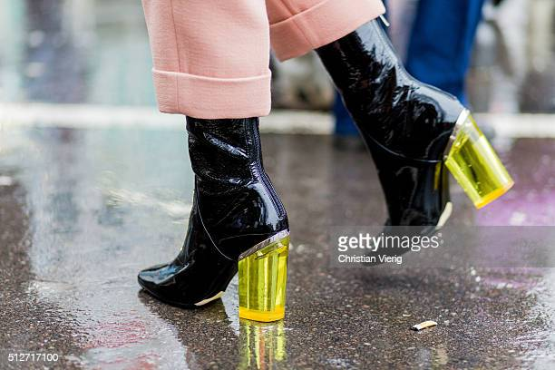 Black Dior boots seen outside Jil Sander during Milan Fashion Week Fall/Winter 2016/17 on February 27 2016 in Milan Italy