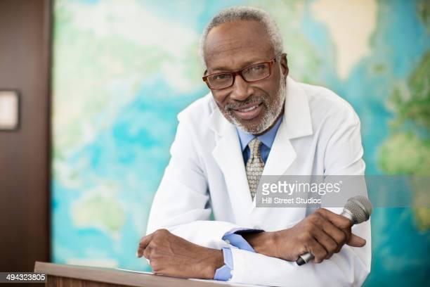 Black doctor giving presentation