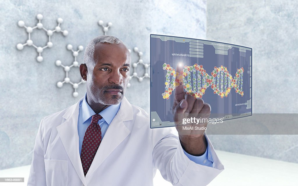 Black doctor using digital display : Stock Photo
