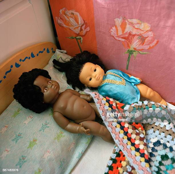 A black doll and a Chinese doll are put to bed side by side in the nursery at Kingsmead Primary School The school primarily serves children who live...
