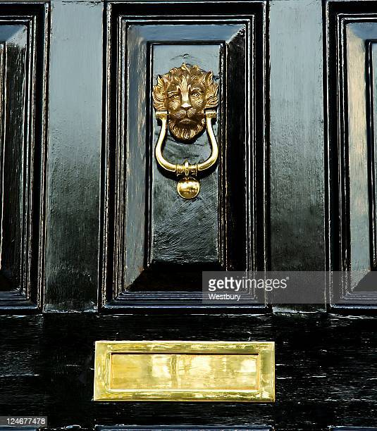 black door - door knocker stock photos and pictures