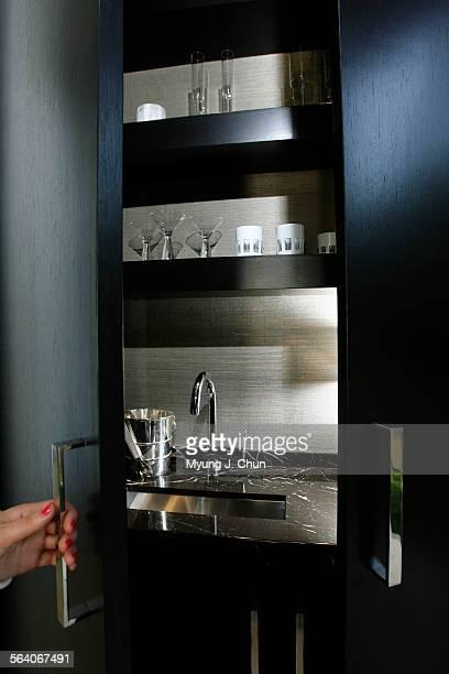 Black Doors Hide The Bar In Corner Of Kitchen Interior Designer Mark Schomisch S