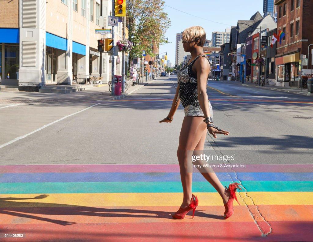 Black drag queen walking on rainbow pavement on city street, Toronto, Ontario, Canada : Stock Photo