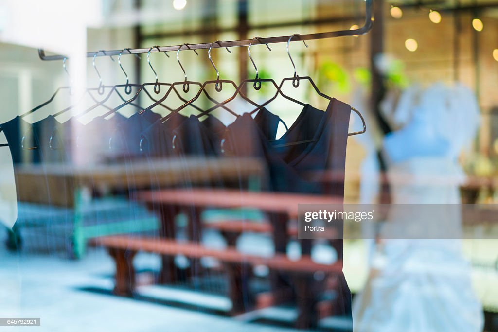 Black dresses arranged on clothes rack : Stock Photo