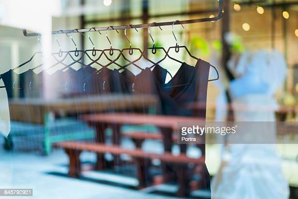 Black dresses arranged on clothes rack
