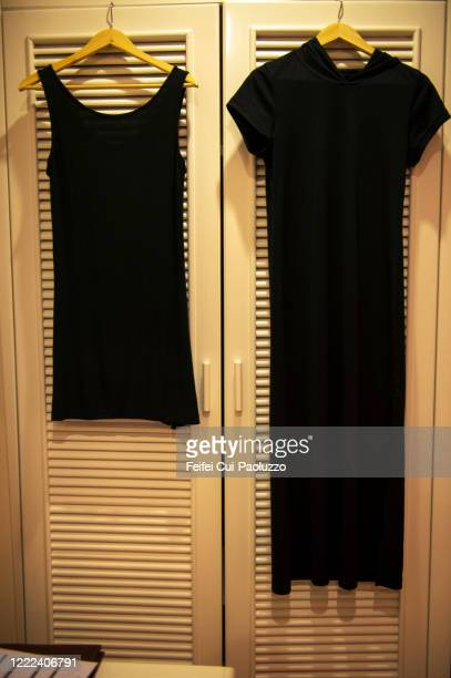 black dresses hanging on the closet at hanoi - black dress stock pictures, royalty-free photos & images