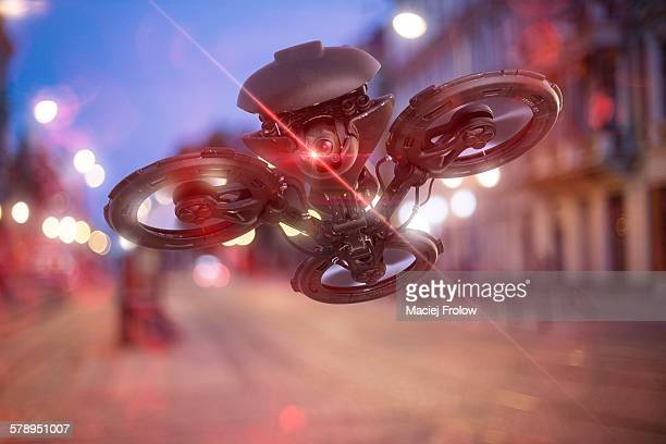 Black drone in the city by night
